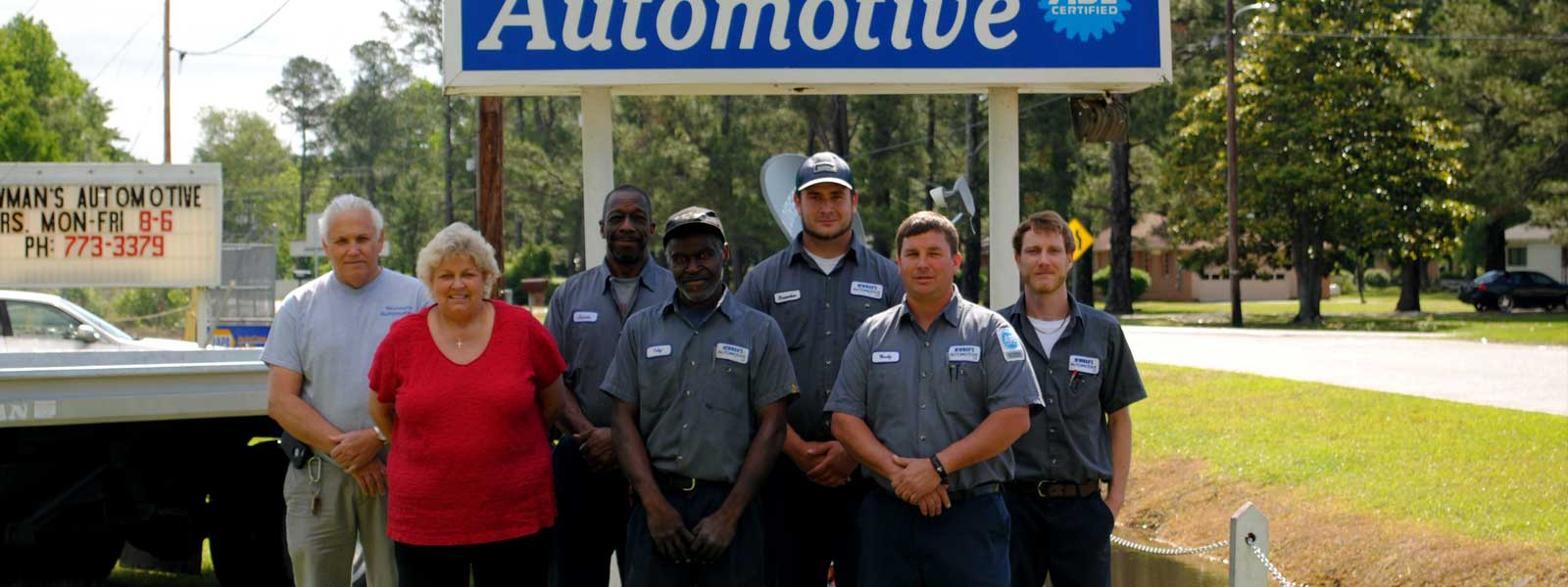 Team and Auto Mechanics at Newman's Automotive